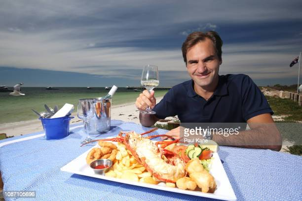 Roger Federer enjoys a seafood feast on the beach at The Lobster Shack ahead of the 2019 Hopman Cup on December 27 2018 in Cervantes Australia