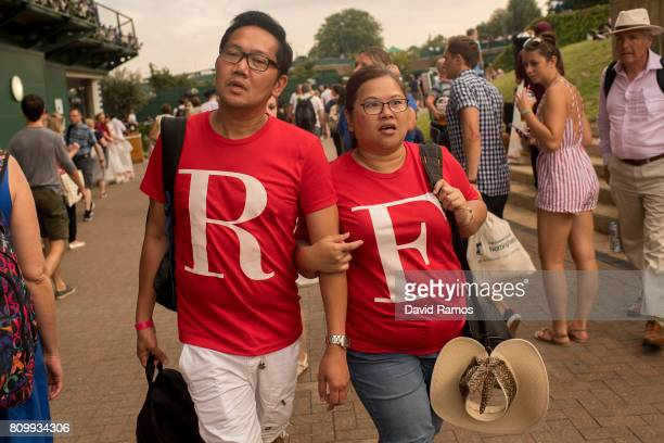 Roger Federer fans walk past Court 1 on day three of the Wimbledon Lawn Tennis Championships at the All England Lawn Tennis and Croquet Club on July...