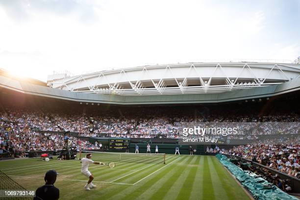 Roger Federer from Switerland in action against Jan-Lennard Struff from Germany on center court during The Wimbledon Lawn Tennis Championship at the...