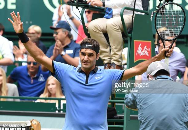 Roger Federer from Switzerland celebrates winning his match against Florian Mayer from Germany during the ATP tournament tennis match in Halle...