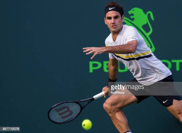Roger Federer from Switzerland in action against Thanasi Kokkinakis from Australia during his second round match at the Miami Open in Key Biscayne on...