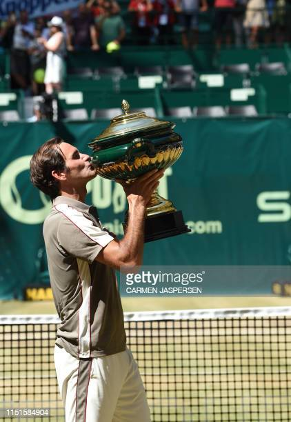 Roger Federer from Switzerland kisses the trophy after he won his final match against David Goffin from Belgium at the ATP tennis tournament in...