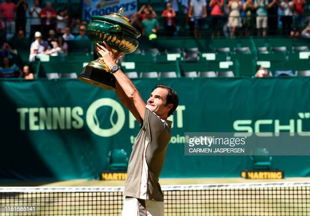 Roger Federer from Switzerland poses with the trophy after he won his final match against David Goffin from Belgium at the ATP tennis tournament in...