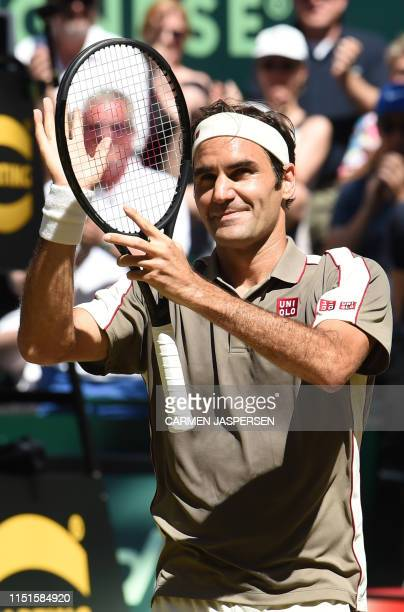 Roger Federer from Switzerland reacts after he won his final match against David Goffin from Belgium at the ATP tennis tournament in Halle, western...