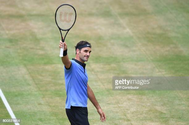 Roger Federer from Switzerland reacts after winning his match against Karen Khachanov from Russia at the Gerry Weber Open tennis tournament in Halle...