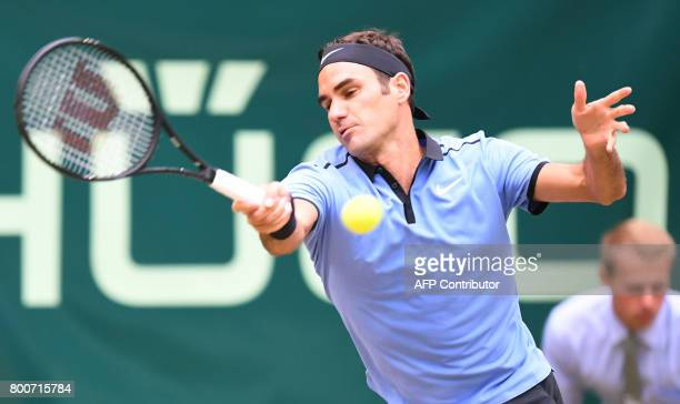 Roger Federer from Switzerland returns a ball to Alexander Zverev from Germany at the final of the Gerry Weber Open tennis tournament in Halle...