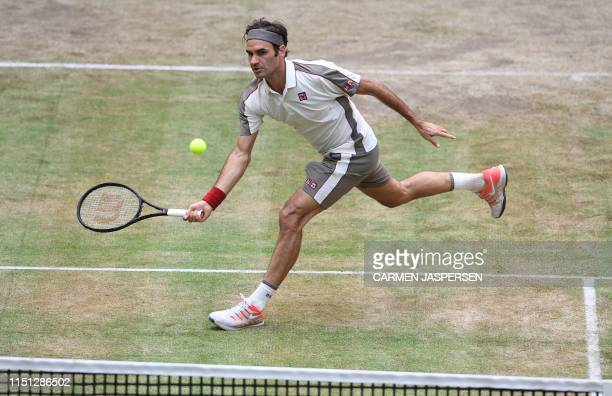 Roger Federer from Switzerland returns during his match against Roberto Bautista Agut from Spain at the ATP tennis tournament in Halle, western...