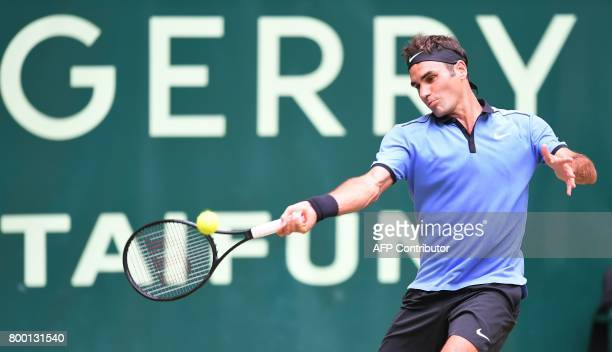 Roger Federer from Switzerland returns the ball to Florian Mayer from Germany during the ATP tournament tennis match in Halle western Germany on June...