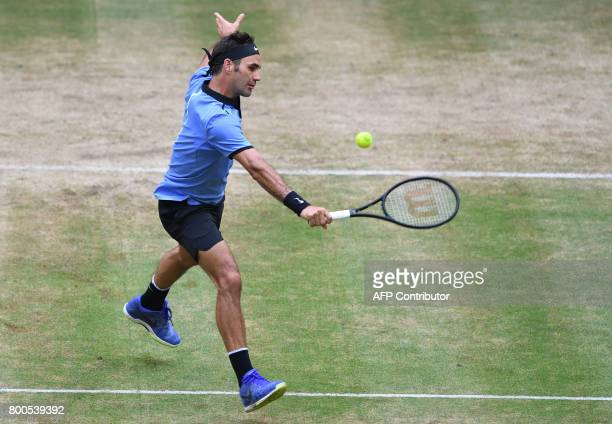 Roger Federer from Switzerland returns the ball to Karen Khachanov from Russia during the ATP tournament tennis match in Halle western Germany on...
