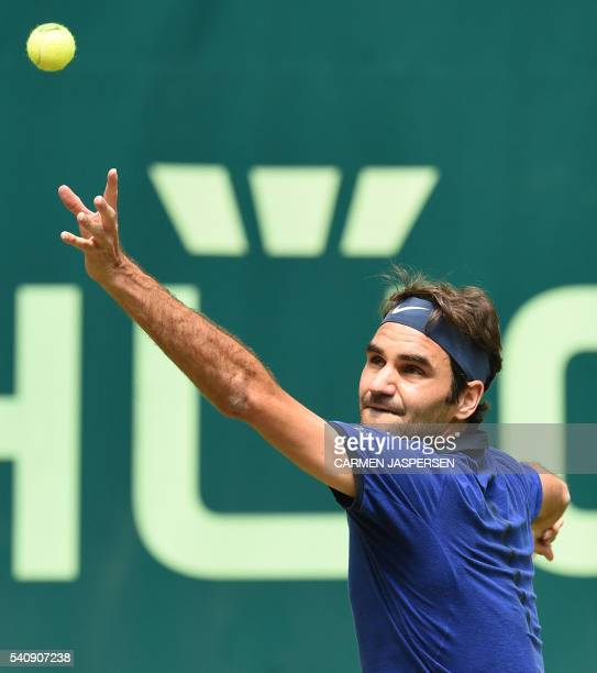 Roger Federer from Switzerland serves during the Tennis match against David Goffin from Belgium in the ATP Tournament match in Halle western Germany...