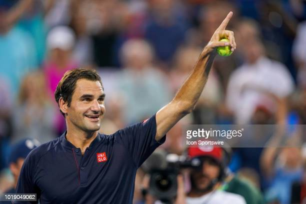 Roger Federer gets the crowd pumped up for signed tennis balls after his match against David Goffin after the semifinal match at the Western Southern...