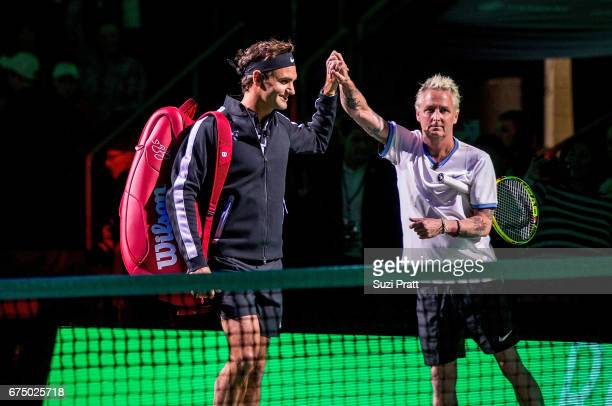 Roger Federer high fives Mike McCready at the Match For Africa 4 exhibition match at KeyArena on April 29, 2017 in Seattle, Washington.