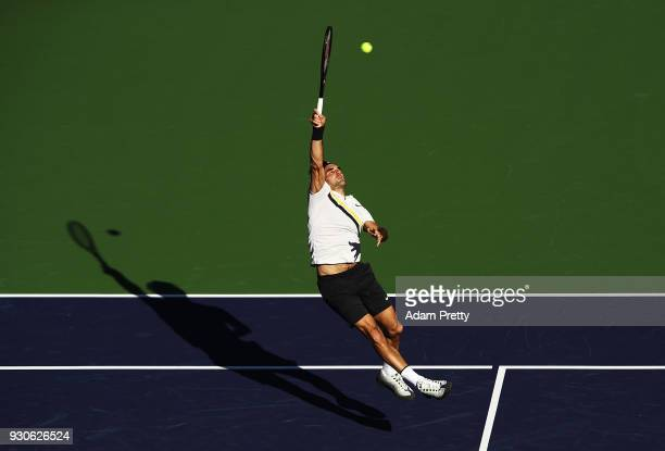 Roger Federer hits a smash during his match against Federico Delbonis of Argentina during the BNP Paribas Open at the Indian Wells Tennis Garden of...