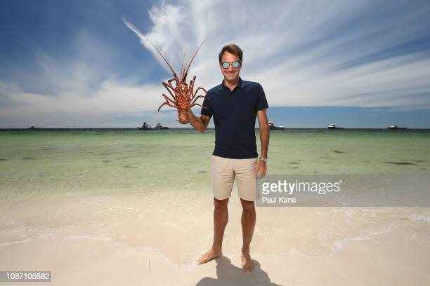 Roger Federer holds a Western Rock Lobster on the beach at The Lobster Shack ahead of the 2019 Hopman Cup on December 27 2018 in Cervantes Australia