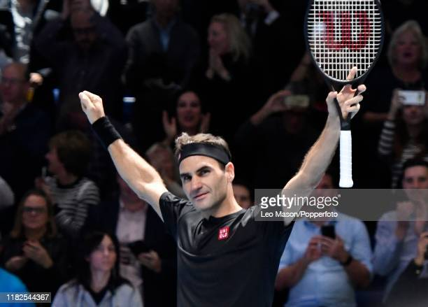 Roger Federer in celebrates his victory over Novak Djokovic during their match on Day Five of the Nitto ATP Finals at The O2 Arena on November 14...