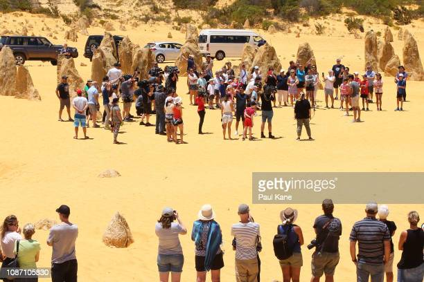 Roger Federer interacts with junior tennis players at the Pinnacles Desert ahead of the 2019 Hopman Cup on December 27 2018 in Cervantes Australia