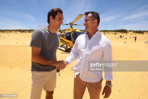 Roger Federer is greeted on arrival at the Pinnacles Desert by West Australian Minister for Tourism Paul Papalia ahead of the 2019 Hopman Cup on...