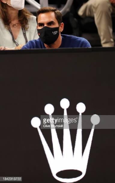 Roger Federer looks on from the front row during the first match during Day 1 of the 2021 Laver Cup at TD Garden on September 24, 2021 in Boston,...