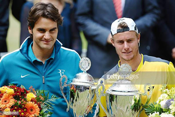 Roger Federer of Suisse and Lleyton Hewitt of Australia pose after their final match during the Gerry Weber Open at the Gerry Weber stadium on June...