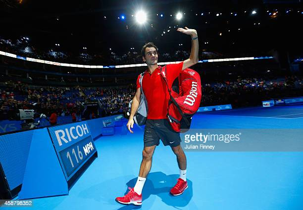 Roger Federer of Switzerland acknowledges the crowd after victory in the round robin singles match against Kei Nishikori of Japan on day three of the...