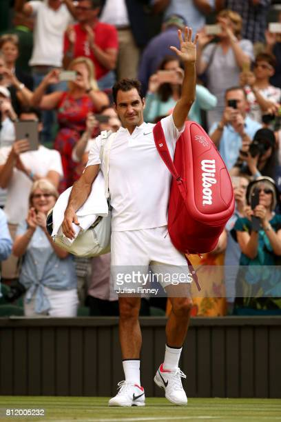 Roger Federer of Switzerland acknowledges the crowd as he celebrates victory after the Gentlemen's Singles fourth round match against Grigor Dimitrov...