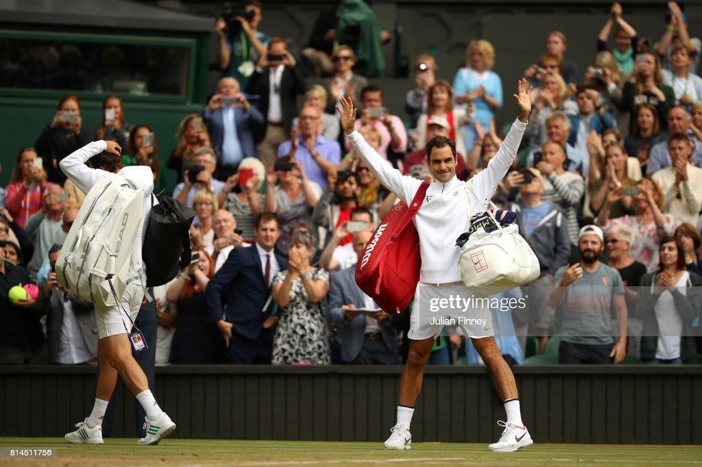 Roger Federer of Switzerland (R) acknowledges the crowd as he celebrates victory after the Gentlemen's Singles semi final match against Tomas Berdych of The Czech Republic (L) on day eleven of the Wimbledon Lawn Tennis Championships at the All England Lawn Tennis and Croquet Club at Wimbledon at Wimbledon on July 14, 2017 in London, England.