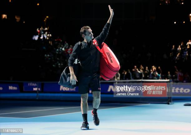 Roger Federer of Switzerland acknowledges the fans as he walks off the court after his singles match victory against Novak Djokovic of Serbia during...