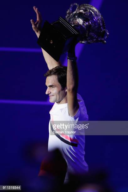Roger Federer of Switzerland acknowledges the fans with the Norman Brookes Challenge Cup after winning the 2018 Australian Open Men's Singles Final...