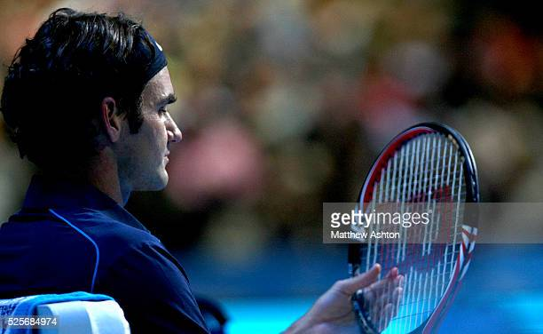 Roger Federer of Switzerland adjusts his strings against Mardy Fish of USA