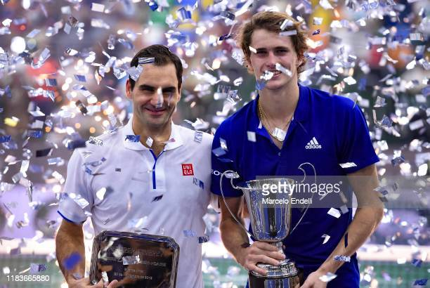Roger Federer of Switzerland and Alexander Zverev of Germany pose with trophies after an exhibition game between Alexander Zverev and Roger Federer...