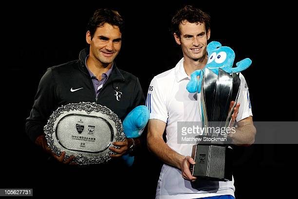 Roger Federer of Switzerland and Andy Murray of Great Britain pose for photographers after the final on day seven of the 2010 Shanghai Rolex Masters...