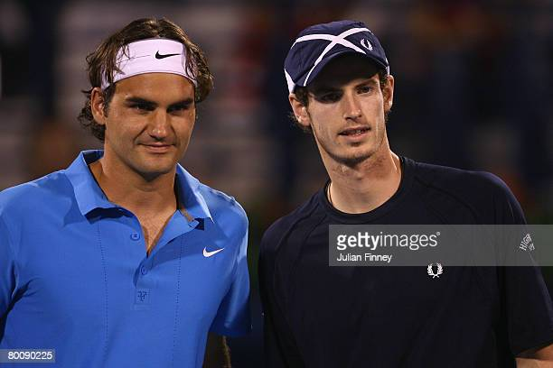 Roger Federer of Switzerland and Andy Murray of Great Britain pose for photos before their match during the ATP Barclays Dubai Tennis Championships...