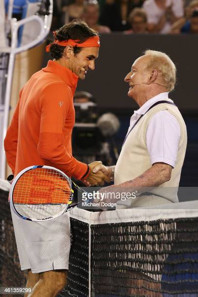 Roger Federer of Switzerland and Australian tennis legend Rod Laver shake hands after a hit during the Roger Federer Charity Match at Melbourne Park...