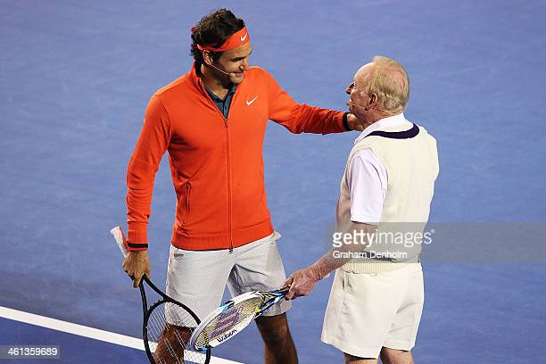 Roger Federer of Switzerland and Australian tennis legend Rod Laver embrace during the Roger Federer Charity match at Melbourne Park on January 8...