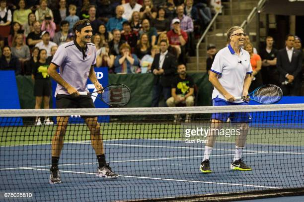 Roger Federer of Switzerland and Bill Gates in action against John Isner of the United States and musician Mike McCready at KeyArena on April 29 2017...