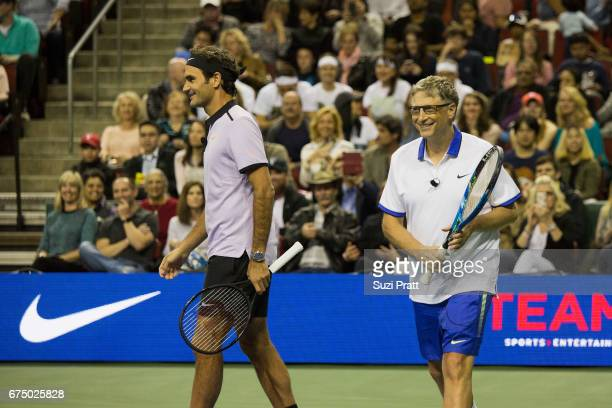 Roger Federer of Switzerland and Bill Gates in action against John Isner of the United States and musician Mike McCready at KeyArena on April 29,...