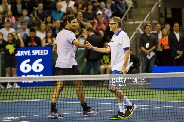 Roger Federer of Switzerland and Bill Gates shake hands at the Match For Africa 4 exhibition match at KeyArena on April 29, 2017 in Seattle,...