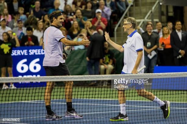 Roger Federer of Switzerland and Bill Gates shake hands at the Match For Africa 4 exhibition match at KeyArena on April 29 2017 in Seattle Washington