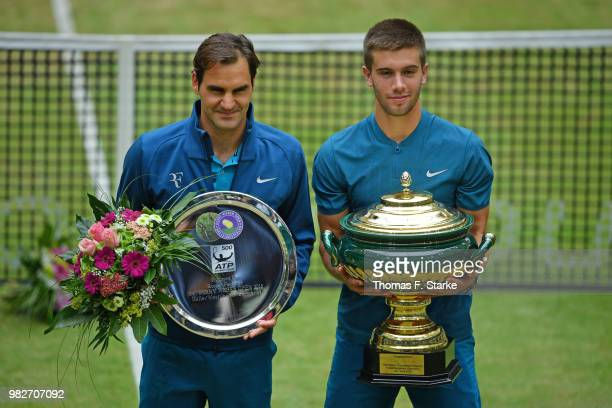 Roger Federer of Switzerland and Borna Coric of Croatia during day seven of the Gerry Weber Open at Gerry Weber Stadium on June 24 2018 in Halle...