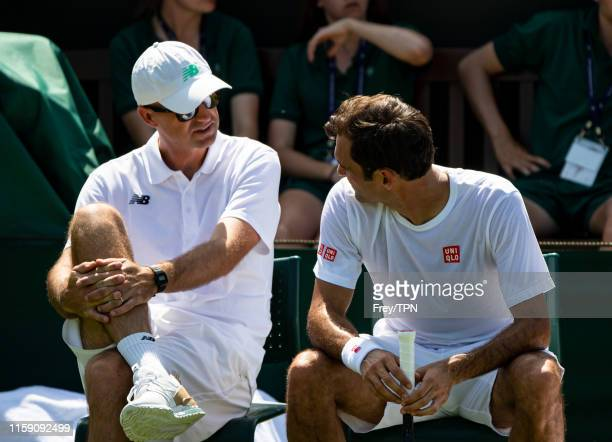 Roger Federer of Switzerland and his coach Ivan Ljubicic during a practice session before the start of The Championships - Wimbledon 2019 at All...