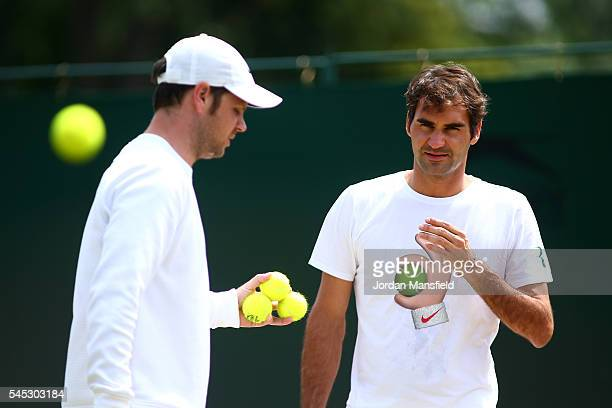 Roger Federer of Switzerland and his trainer Severin Luthi look on during practice on day ten of the Wimbledon Lawn Tennis Championships at the All...