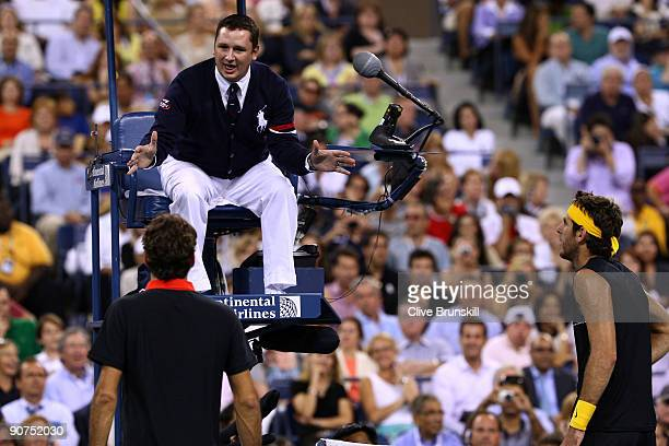 Roger Federer of Switzerland and Juan Martin Del Potro of Argentina dispute a call to chair judge Jake Garner during the Men�s Singles final on day...
