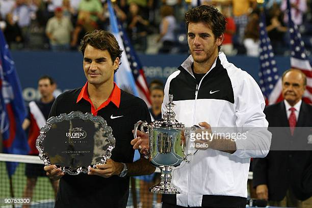 Roger Federer of Switzerland and Juan Martin Del Potro of Argentina pose with their trophies after the Men's Singles final on day fifteen of the 2009...