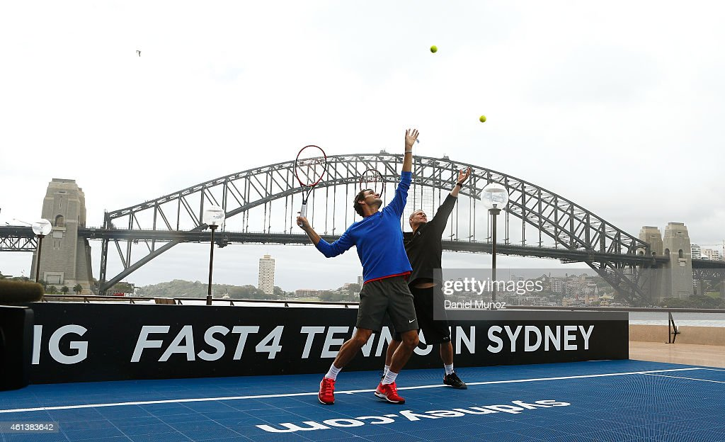 Roger Federer of Switzerland and Lleyton Hewitt of Australia hit some balls for the cameras during the launch of Fast 4 Tennis in front of the Sydney Harbour Bridge on January 12, 2015 in Sydney, Australia.
