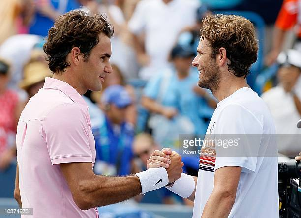 Roger Federer of Switzerland and Mardy Fish during the finals on Day 7 of the Western & Southern Financial Group Masters at the Lindner Family Tennis...