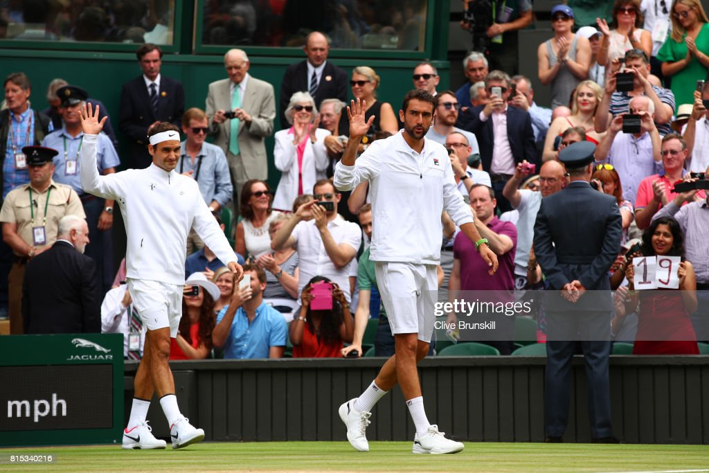 Roger Federer of Switzerland and Marin Cilic of Croatia acknowledge the crowd as they walk onto court prior to Gentlemen's Singles final on day thirteen of the Wimbledon Lawn Tennis Championships at the All England Lawn Tennis and Croquet Club at Wimbledon on July 16, 2017 in London, England.