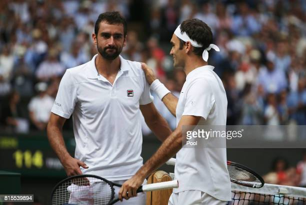 Roger Federer of Switzerland and Marin Cilic of Croatia shake hands after the Gentlemen's Singles final on day thirteen of the Wimbledon Lawn Tennis...