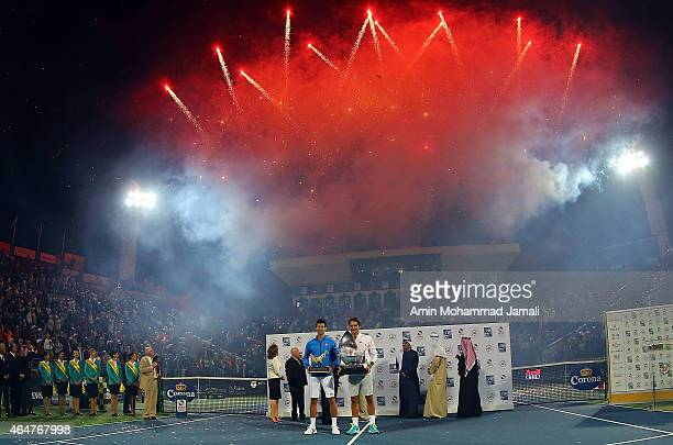 Roger Federer of Switzerland and Novak Djokovic of Serbia holds the trophy after winning the final match during men's singles Final match of the ATP...