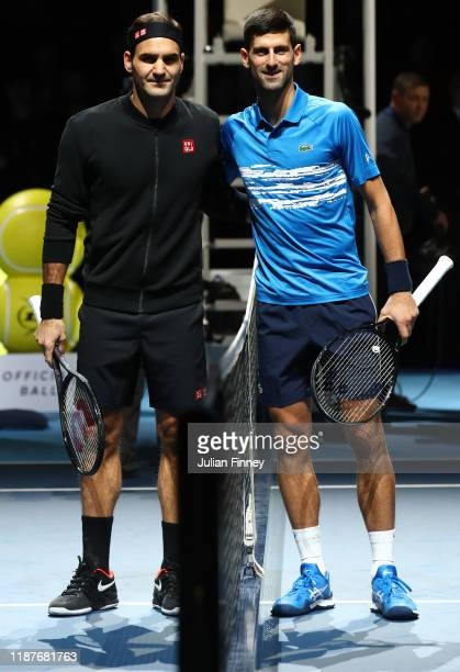 Roger Federer of Switzerland and Novak Djokovic of Serbia pose for a photo at the net prior to their singles match during Day Five of the Nitto ATP...
