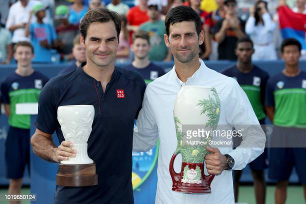 Roger Federer of Switzerland and Novak Djokovic of Serbia pose for photographers after their match during the men's final of the Western Southern...